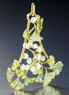 An Art Nouveau enamel, pearl and diamond pendant by Vever, circa 1900. Designed as a triangular, openwork spray of ginkgo biloba, the leaves in green and pink plique-à-jour enamel, with baroque pearl seeds and a rose-cut diamond frame, signed Vever Paris, numbered, French assay mark.