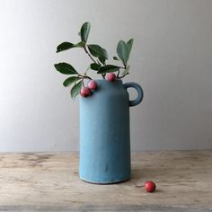 New blue stoneware flower vases added to the shop. Pair with fall crabapple trimmings for the perfect autumn table.