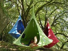 Modern Hammock: Cacoon A cross between a hanging tent and a hammock, the Cacoon is a chic and cozy hideaway. Snuggle into the fully-enclosed hanging chair to lounge or relax to your heart's content.