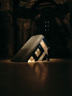 Hungarian artist Zsuzsi Csiszer's installation titled Átjárás, which translates as Passage, features half of a train car bursting through the floor in the Templespace of Museum Kiscell.