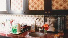 Fabric as backsplash and back of cabinet. Peter Dunham.