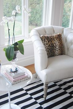 white chair, orchid, black and white stripe rug, leopard pillow, tulip table.  PERFECTION!