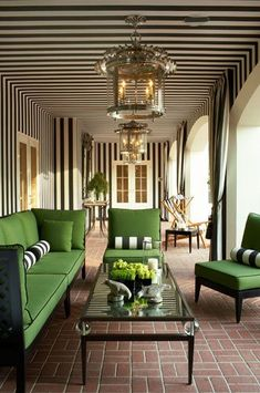 Green furniture in a sunroom/porch