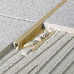 braSS floor transitions between floor materials Floor Patterns, Tile Patterns, Floor Design, Tile Design, Tiled Hallway, Tile Trim, Terrazo, Floor Finishes, Kitchen Flooring