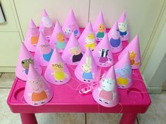 Peppa Pig Party Hats. Plain pink hats, then print off characters from the Internet and paste them on. Each of the 20 hats has a different character :)