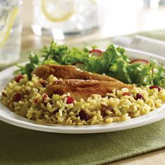 Easy to make, easy on the belly. Yellow rice and cranberries give this side its New Orleans-style flavor. Serve this gluten-free recipe alongside the holiday roast or turkey. Add slivered almonds for a festive look.