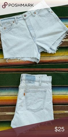 """Vintage Levis orange tab cutoffs 100% cotton in a great light wash, made in the USA!  Just a little bit longer in the back to cover your booty.    33"""" waist 12"""" front rise 15"""" Total length Levi's Shorts Jean Shorts"""