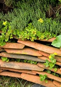 Low retaining wall made from roof tiles
