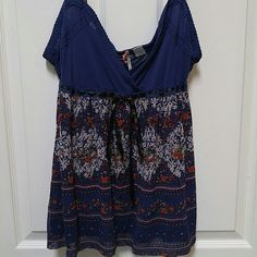 Anthopologie RiccRac Blue Flower sheer Tank Top Beautiful sheer flower tank top. Gently worn with no flaws. Size L. 100% Nylon. Ties in front with satin ribbon. Anthropologie Tops Camisoles