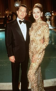 Robert De Niro and Sharon Stone in Casino.... So obsessed with the dress she has on in this pic, If ever in my life I go to prom, a dress like this will be my goal to find!