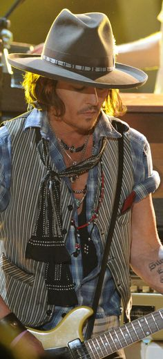 Johnny Depp rocking a knotted hippie scarf