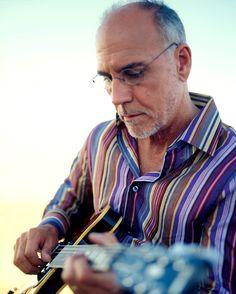 "Jazz pro Larry Carlson plays guitar on Olivia Newton-John's album ""Soul Kiss""."
