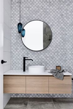 28 Bathroom Wall Decor Ideas to Increase Bathroom's Value wall In this modern bathroom, fish scale tiles (also known as scalloped or fan tiles) have been used to create a decorative accent wall, while the blue light fixture adds a pop of color. Modern Bathroom Tile, Bathroom Interior Design, Bathroom Black, Bathroom Mirrors, Minimalist Bathroom, Bathroom Cabinets, Restroom Design, Marble Bathrooms, Luxury Bathrooms