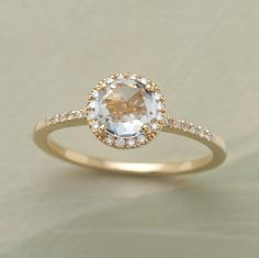 Rose-cut white topaz surrounded by diamonds in 18K gold, $1495.        Read More http://www.glamour.com/weddings/blogs/save-the-date/2011/12/6-fantastically-amazing-non-tr.html#ixzz1gAeQn575    http://www.sundancecatalog.com/product/handmade+jewelry/unique+rings/multi+stone+rings/white+rose+ring.do?sortby=ourPicks