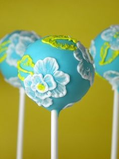 Gorgeous cake pops using brushed embroidery take royal icing and use a paintbrush and brush the icing inward