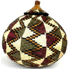 Love the colors in this Zulu basket - woven by Jabu Mhlungu. $250 onsite