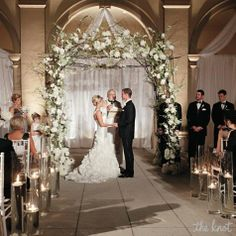 The Elegant Ceremony:  Use Icey branches on the arch.
