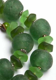 """Beautiful glass beads handmade from recycled glass and mixed with """"sea Glass"""" in shades of green."""
