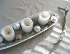 Surf, sand, ornaments.  Great candle Christmas idea for lighting.