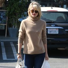 Ali Larter Perfects the Camel Turtleneck With Leopard Flats