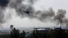 Ukraine: At least 30 separatists killed during clashes at Sergei Prokofiev Airport in Donetsk Ukraine News, Sergei Prokofiev, Europe News, Military Helicopter, Paratrooper, Rebel, Fighter Jets, Battle, Aircraft