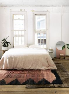 Layered rugs would make our home warmer in the winter. Extra insulation while making it feel cozier and more textural.