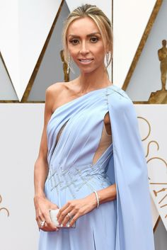 Giuliana Rancic looks like a gorgeous goddess on the Academy Awards red carpet wearing an 11.03 ct Cushion Cut Forevermark Exceptional Diamond ring, long diamond drop earrings, and a classic diamond tennis bracelet.