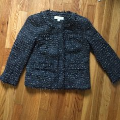 Chanel-Style Blazer This Michael Kors blazer is stunning! Totally looks like Chanel with the thread pattern and fringe on seams. 3/4 sleeves and silver snap buttons. Never worn! Looks navy blue in certain lights MICHAEL Michael Kors Jackets & Coats Blazers