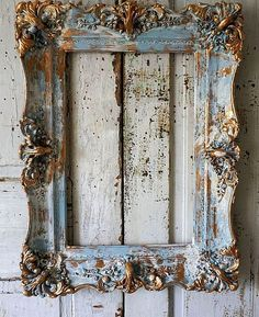 Distressed blue picture frame accented gold wood gesso rustic antique farmhouse hints of white shabby cottage home decor anita spero design Distressed picture frame wall.