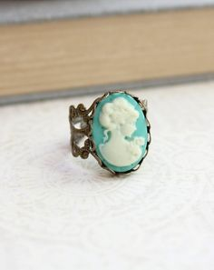 This is a vintage style lady's profile cameo ring. The classic style silhouette aqua and ivory cream cameo is beautiful and romantic set on a lacy filigree band. by apocketofposies $19.00