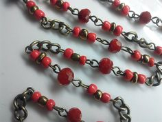 36 Inches Vintage 6 mm Red faceted round Glass Bead Brass Chain with 4 mm Gold and Red Bead Accent, Jewelry Making Supply. Just Add Clasps.   All pre-linked with brass loops to save you time. They are made with 6 mm deep red faceted round glass beads, 4 mm Gold and Red smooth round Bead Accent with 3 mm x 5 mm 1 long chain in between every section.   The listing is for 36 inches glass beaded chain. Thank you for viewing the shop! More beaded chain listings: http://www.etsy.com/...
