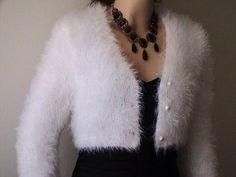 Hand Knit White Angora Cardigan Bolero  inspired by Royal Wedding Kate Middleton White Angora Cardigan Ready to ship. $190.00, via Etsy.