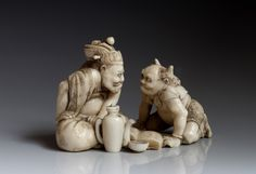 Two Oni in conversation- antique Ivory Netsuke