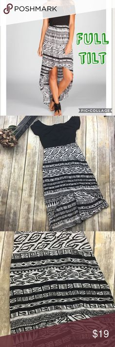 🎈 Full Tilt High Low Black And White Dress Black and white high low dress. Size medium. In excellent used condition. Zips up in the back. Front of dress is 29 inches long. 50 inches long in the back. Rayon spandex material. Full Tilt Dresses High Low