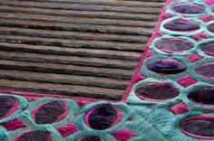 Custom rug shown in Azalea, Caribbean, Charcoal, Graphite and Violet