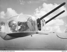 McDonald, NT. 4 May 1943. An air gunner of No. 18 (Netherlands East Indies) Squadron seated in the turret of a North American B25 Mitchell bomber aircraft of the Squadron.