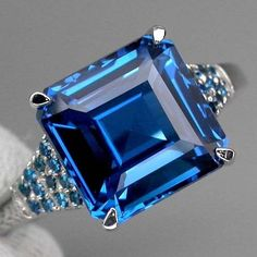 I'd like a smaller version of this stunner: Stunning Vintage Perfect Princess Cut Swiss Blue Topaz and Round Diamond Cut Paraiba Blue Apatite Anniversary Wedding Ring Pretty Rings, Beautiful Rings, Wedding Anniversary Rings, Wedding Rings, Jewelry Gifts, Fine Jewelry, Diamond Are A Girls Best Friend, Blue Topaz, Round Diamonds