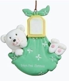"Baby's First Christmas Ornament - Bear.  This cute little polar Bear, wrapped in a baby blanket reads, ""Baby's First Christmas"" Ornament can be personalized with a marker. Makes a great baby shower gift."
