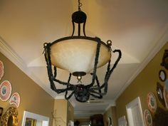 oh yeah! I wish I'd thought to use my big ol' pose-able spider this way when we had this kind of fixture.