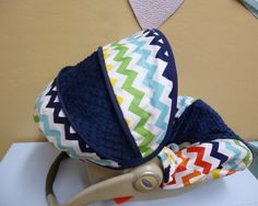 Rainbow Chevron with Navy Infant Carseat Cover. $65.00, via Etsy.