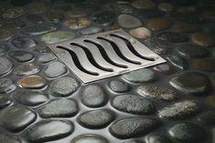 Decorative Shower Drain Design - rocks for the shower, love it