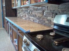 The rock backsplash is in, still working on cabinets.