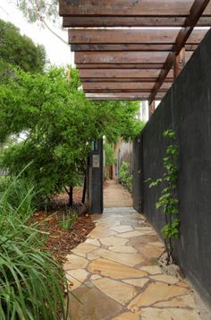 Love everything about this, from the privacy and shade to the paving and plantings!