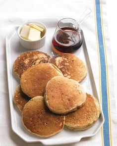 Cinnamon-Oat Pancakes | Martha Stewart Living - Rolled oats give these pancakes a hearty, nutty flavor. Make them ahead, then warm them in the morning with butter and maple syrup or powdered sugar and bananas.
