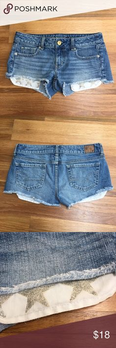 American Eagle Glitter Star Denim Booty Shorts Excellent used condition! Some of the stars' glitter is coming off. They came fade made with the stars! Size 4. Smoke and pet free home. No trades. American Eagle Outfitters Shorts Jean Shorts
