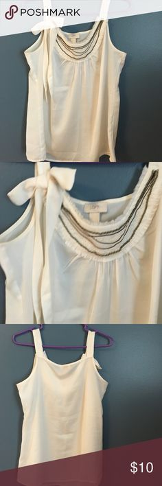 """Cute LOFT top LOFT top with beaded detailing. Really cute with a bow in one sleeve. Underarm width 19"""". Shoulder to hem 26"""". Can also fit medium. LOFT Tops"""