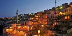Argos in Cappadocia: The area's ancient cave dwellings and stone churches are romantically lit at night.