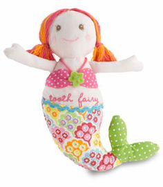 """mermaid tooth fairy doll  The Tooth Fairy even makes visits under the sea! When kids tuck a lost tooth into her pocket, this lovely mermaid will swim it away to the Tooth Fairy. Magic! Measures 9"""". Cotton, polyester fill. Spot clean. Imported."""