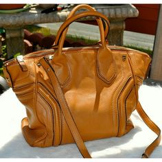 """Milly Cognac Convertible Tote $465 Used only a handful of times, very minimal normal signs of wear on bottom four corners. Big enough to fit a MacBook Pro. Measures 16.5"""" wide, 12"""" high, 3.5"""" depth and 21.5"""" strap drop. Milly Bags Totes"""