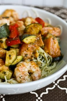 Shrimp, Zucchini & Tomato Pesto Cook some red peppers and zucchini, sear some shrimp, use some salt, boil some angel hair, mix it all together, add pesto to taste! chopped a big tomato in cubes and put them in right at the end of cooking just to warm.